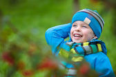 Adorable little boy having fun in autumn park — Stock Photo