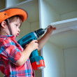 Cute little boy using an electric screwdriver — Stock Photo #26832575