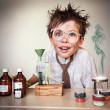Crazy scientist. Young boy performing experiments — Stok fotoğraf