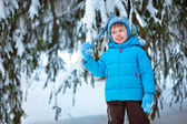 Cute little boy playing outdoors in a forest — Stock Photo