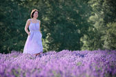 Beautiful woman relaxing in lavender field — Stock Photo