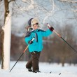 Stock Photo: Cute little boy skiing on cross