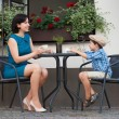 Stock Photo: Mother and son sitting in outdoor cafe