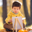 Cute little boy painting with brush — Stock Photo #33663565
