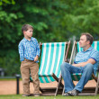 Happy father and son having rest in city park — Stock Photo