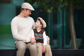 Happy father and son having rest outdoors in city — Stock Photo