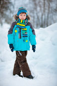 Portrait of cute little boy in winter clothes — Stock Photo