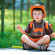 Portrait of a cute little boy in summer forest — Stock Photo