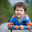 Admiring little boy laughing outdoors — Stock Photo