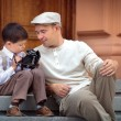 Stock Photo: Father and little son with retro camera outdoors