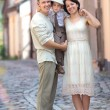Young family of three in city street — Stock Photo #38806205
