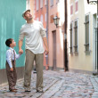Father and son walking outdoors in city — Stock Photo #38806227