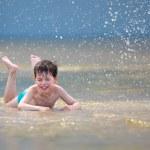 Happy little boy having fun at the beach — Stock Photo