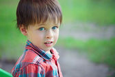 Close-up portrait of cheerful little boy — Stock Photo