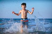 Cute little boy having fun at the beach — Stock Photo