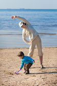 Mother and son enjoying time at the beach — Stok fotoğraf