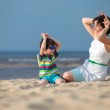 Mother and son having fun beach vacation — Stock Photo #38810143