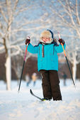 Cute little boy having fun during skiing on cross — Stock Photo