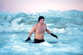 Winter swimming. Man in an ice-hole — Stock Photo