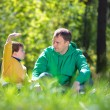 Happy father with his little son outdoors — Stock Photo