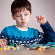 Stockfoto: Five years old boy playing with building blocks