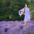 Young woman relaxing in lavender field — Stok fotoğraf