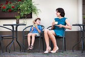 Young mom having coffee with her son — Stock Photo