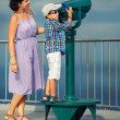 Mother and son looking through binoculars — Stock Photo #46045257