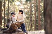 Mother and her little son sitting on a bench — Foto Stock