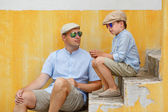 Happy father and son talking and having rest outdoors in city — Stock Photo