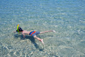 Little boy swimming in a shallow water — Stock Photo