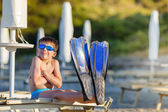 Boy with snorkeling equipment at tropical beach — Stock Photo
