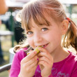 Girl eat pickle — Stock fotografie