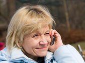 Mature woman with cell phone — Stock Photo