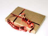 Gift in gold and red — Stock Photo