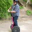Foto Stock: Men having fun on segway