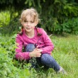 Stock Photo: Little girl in the garden