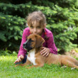 Stock Photo: Girl with puppy