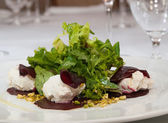 Beetroot salad with goat cheese — Stock Photo