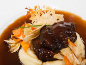 Veal cheeks with ashed poptatoes — Stock Photo