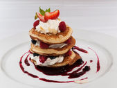 Pancake with raspberries — Stock Photo