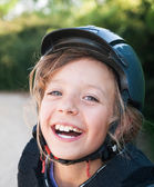 Girl in helmet for horseriding — Stock Photo