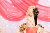 Wedding Cake With Figurines of Bride and Groom — Stock Photo