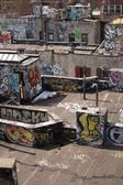 Rooftops with graffiti artwork — Stock Photo