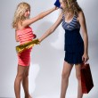 Two girls of teenager swing paper packages for purchases - Stock Photo