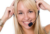 The cheerful girl with earphones and a microphone — Stock Photo