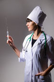 A female doctor with a syringe — Stock Photo