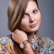 Portrait of a young beautiful girl with hand clock — Stock Photo