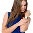 Attractive businesswoman looking at her watch — Stock Photo