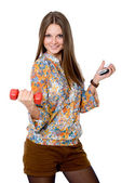Portrait of a smiling young woman with dumbbell in one hand and — Stock Photo
